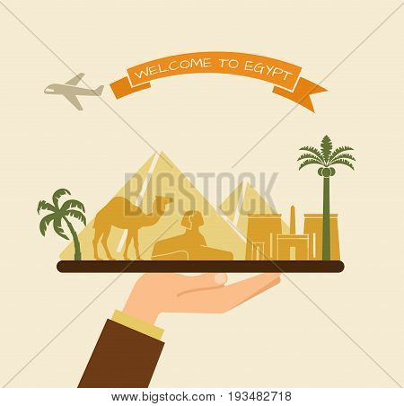 The hand holds the sights of Egypt on a tray. The plane and the words welcome to Egypt on the ribbon