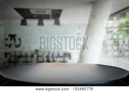 Selected focus empty black wooden table and meeting room or office work blur background image. for your photomontage or product display.