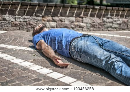 unconscious guy after heart attack in the outdoor