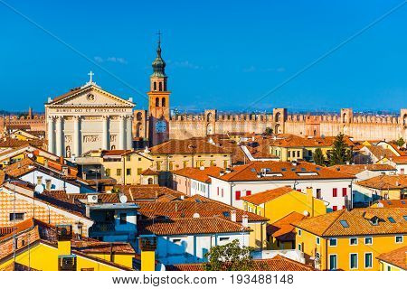Italian city skyline. Walled town of Cittadella. Cityscape of the Medieval fortress-town. Text in Latin: