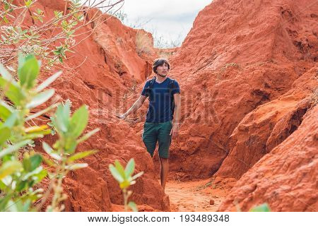 Young Man In Red Canyon Near Mui Ne, Southern Vietnam