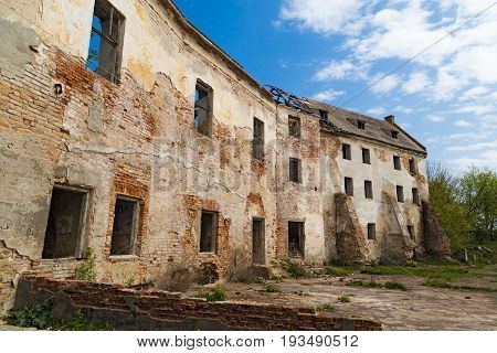 Ruins of the old Klevan castle. Ruined wall with windows against the blue sky. Courtyard. Rivne region. Ukraine