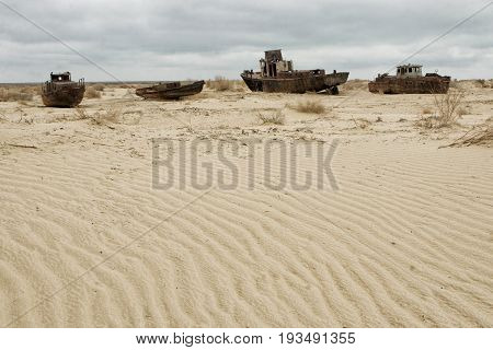 Old ships in the desert ship cemetery the consequence of Aral sea disaster Muynak Uzbekistan