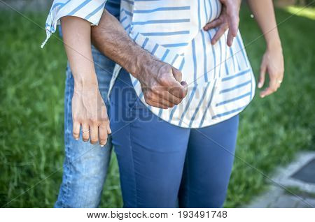 guy making the heimlich maneuver to a girl while she's chocking