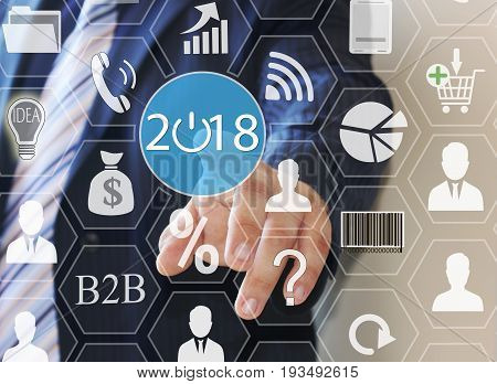 Businessman Pushing 2018 On Virtual Screens . Business Innovation,business Vision , Webinar, Launch