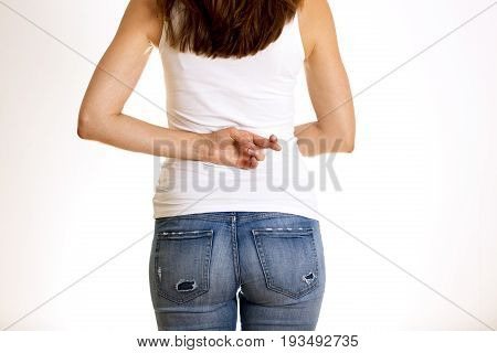 Dishonest woman telling lies lying female holding fingers crossed behind her back