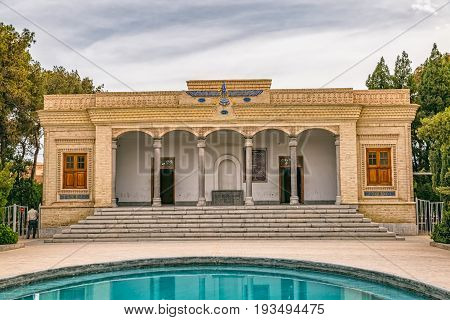 YAZD, IRAN - MAY 5, 2015: Tourists visiting the zoroastrian fire temple Atash Behram in old city.