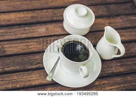 Coffee Cup On Wood Table In Cafe Vintage Tone