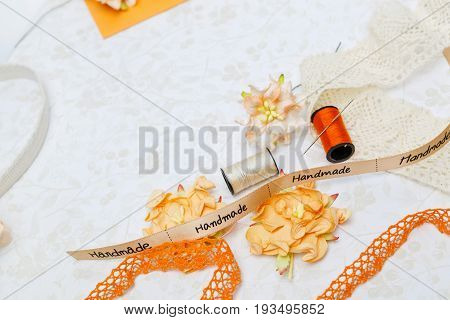 beautiful set of orange vintage materials for scrapbooking craft on flower design paper. Copy space.