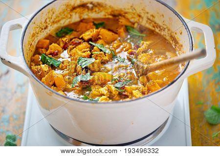 Moroccan tajine - fried chicken with pumpkin cranberries, feta and mint