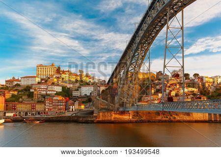 Douro river, Ribeira and Dom Luis I or Luiz I iron bridge in the sunny morning Porto, Portugal.