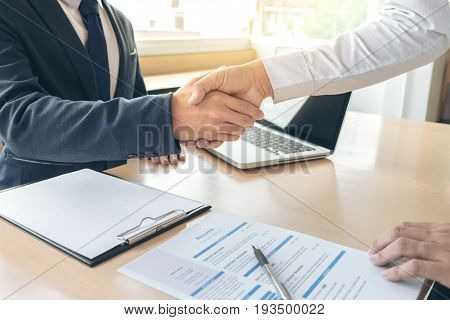 Job applicant having interview Welcome to team Business people handshake with executive manager to Sign Approval Into the company business meeting Greeting deal congratulation.