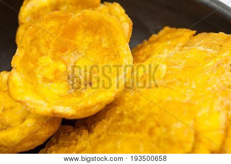 Plantain cups and patacones on traditional black ceramic dish