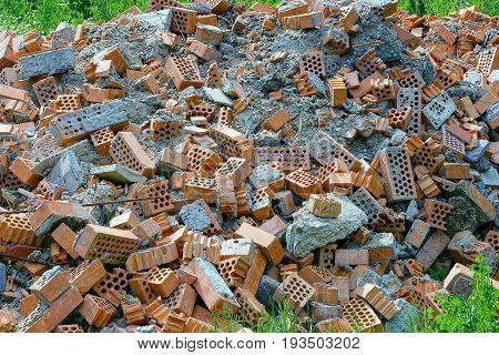Building debris from broken bricks and tiles in the grass
