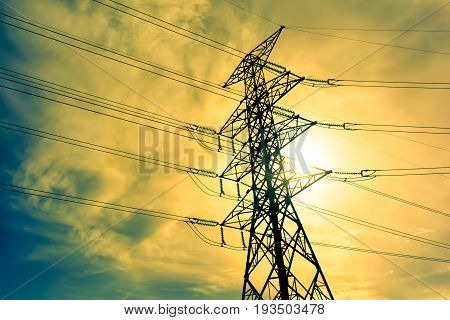 High voltage post. Silhouette of High-voltage tower.