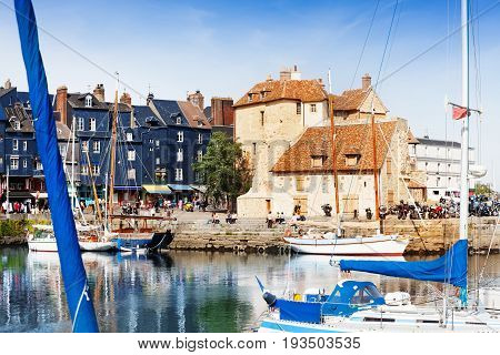 Scenic architecture of old pier and sailing ships at Honfleur, France