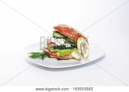 Freshness delicious sandwich with fish on plate against white background