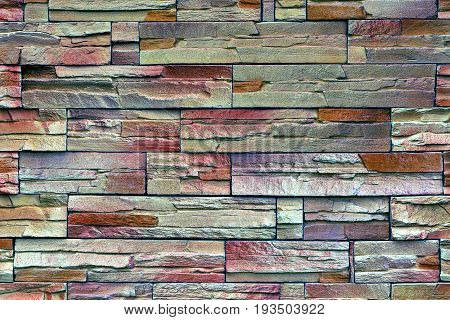 Stone texture of a colored brick wall at home