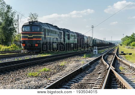 Freight trains on the track. The locomotive is pulling wagons of different types.