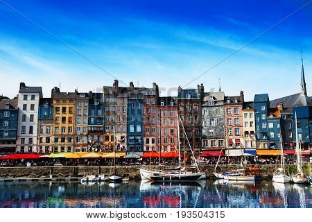 Waterfront of Honfleur harbor with color houses in Normandy, France