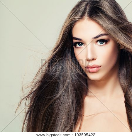Fashion Beauty Portrait of Cute Woman with Long Brown Hair. Makeup Hairstyle and Cute Face. Beauty Salon Background