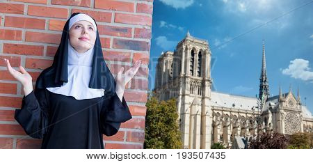 Young Smiling Nun Standing Near Brick Wall