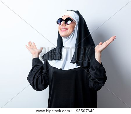 Young Smiling Nun With Sunglasses