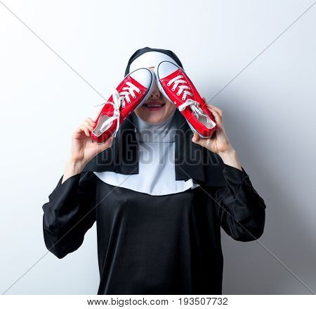 Young Smiling Nun With Red Gumshoes