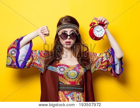 Young Hippie Girl With Sunglasses And Alarm Clock