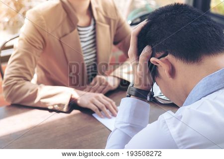 Close up of the hand employer filing final remuneration to employee Man has stressed Resignation resign concept. poster