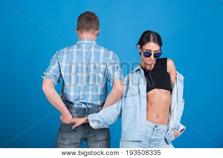 Man With Back And Girl In Glasses