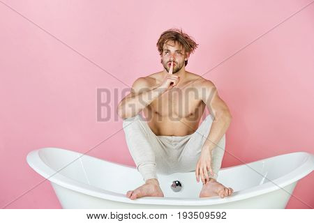 Handsome Young Man With Muscular Body Sitting In White Bathtub