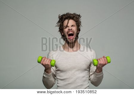Sleepy Man With Barbell Doing Morning Exercise, Has Uncombed Hair