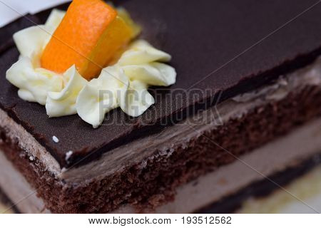 Close and macro view on the delicious layers of Jaffa cake...made from chocolate and orange on the qhite/red plate...https://www.facebook.com/medimurskagibanica/