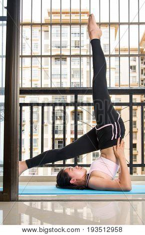 Girl Doing Shoulder Stand Yoga Pose Variation
