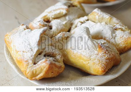 Puffs With Apple Jam And Sugar Powder On A White Plate
