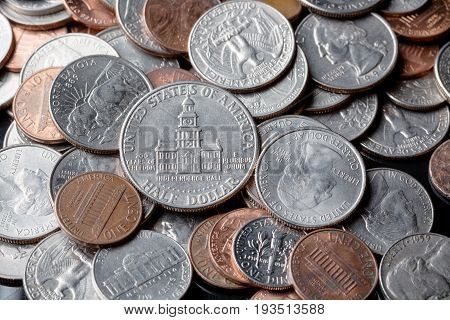 Close up of american US dollar coins as a background. Finance concept.