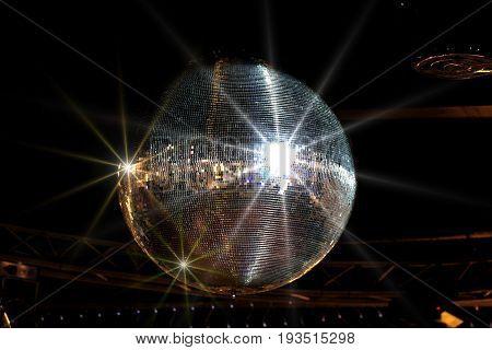 Shining disco ball close up image .