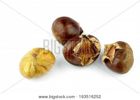 Roasted chestnuts on white background close up image
