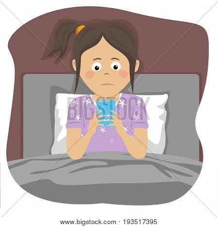 Teenager girl uses a smartphone sitting in bed at night
