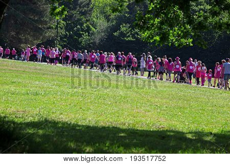SOUTHAMPTON UK - July 2 2017: Race for Life women run and walk to raise money for Cancer Research charity in Southampton UK. Women anc children walking on the path during the Race for Life.