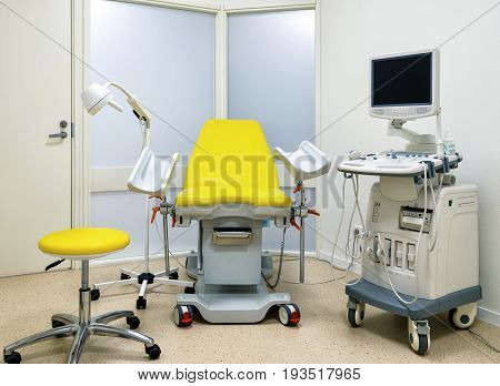Gynecological cabinet with chair and other medical equipment
