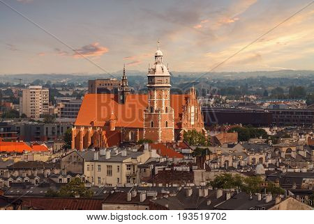 Roofs and the church in sunset light. Krakow Poland.