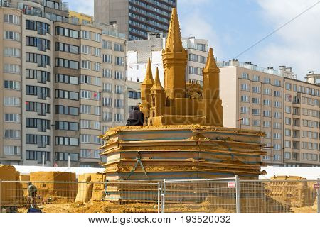 OSTENDE BELGIUM - JUNE 9 2017: Preparation for Sand Sculpture Festival. Sculptures from sand in the course of creation