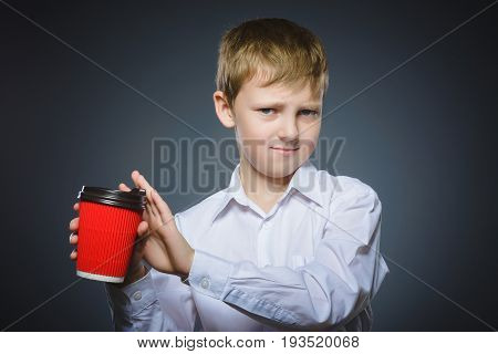 boy does not want to drink coffee. The child does not like the beverage.