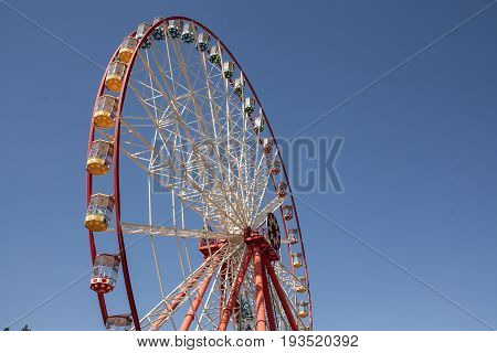 Carnival Ferris Wheel with Clean Skies with Empty Space Close up shot of half of a ferris wheel Copy space