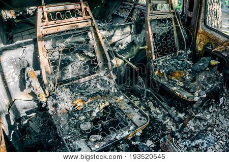 Burned out car, Burnt seats with springs, inside view