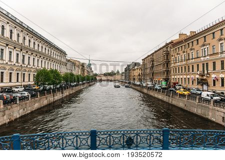 Saint Petersburg, RUSSIA - MAY 31, 2017: Embankment of St. Petersburg, rivers and canals of the old city, view of the canal from the bridge, perspective, old beautiful architecture