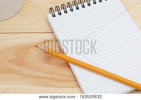 Blank Spiral Notebook With Pencil Laying On Wooden Desk. Modern Designer Home Desk Table With Blank