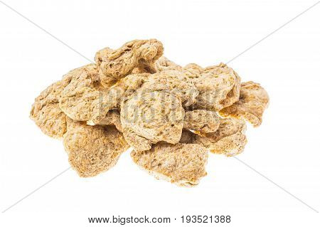 Raw dehydrated soy meat  on white background. Studio Photo